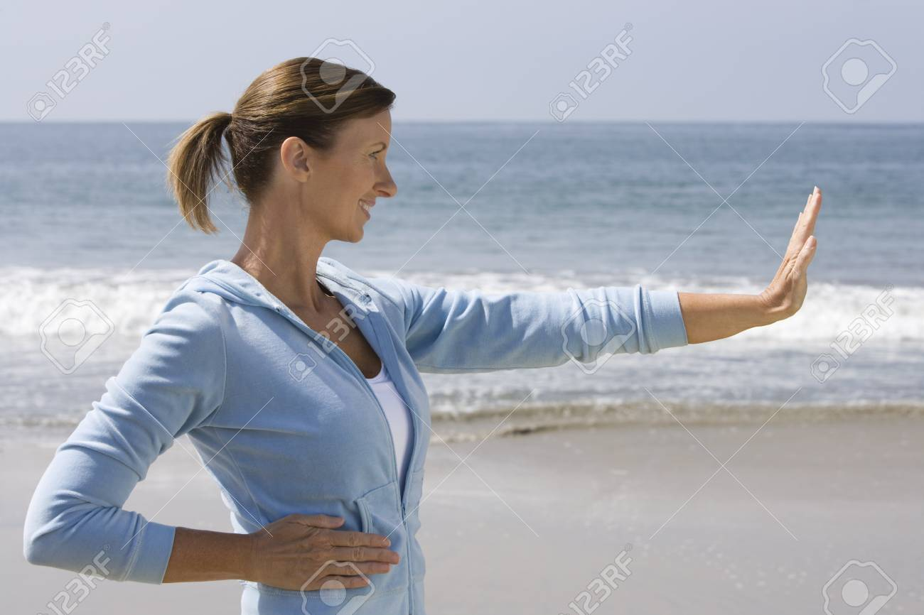 Woman exercising at beach Stock Photo - 12737790