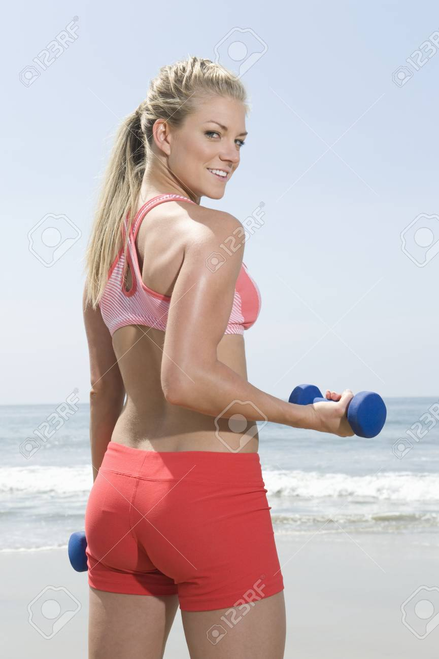Young woman lifting hand weights Stock Photo - 12737814