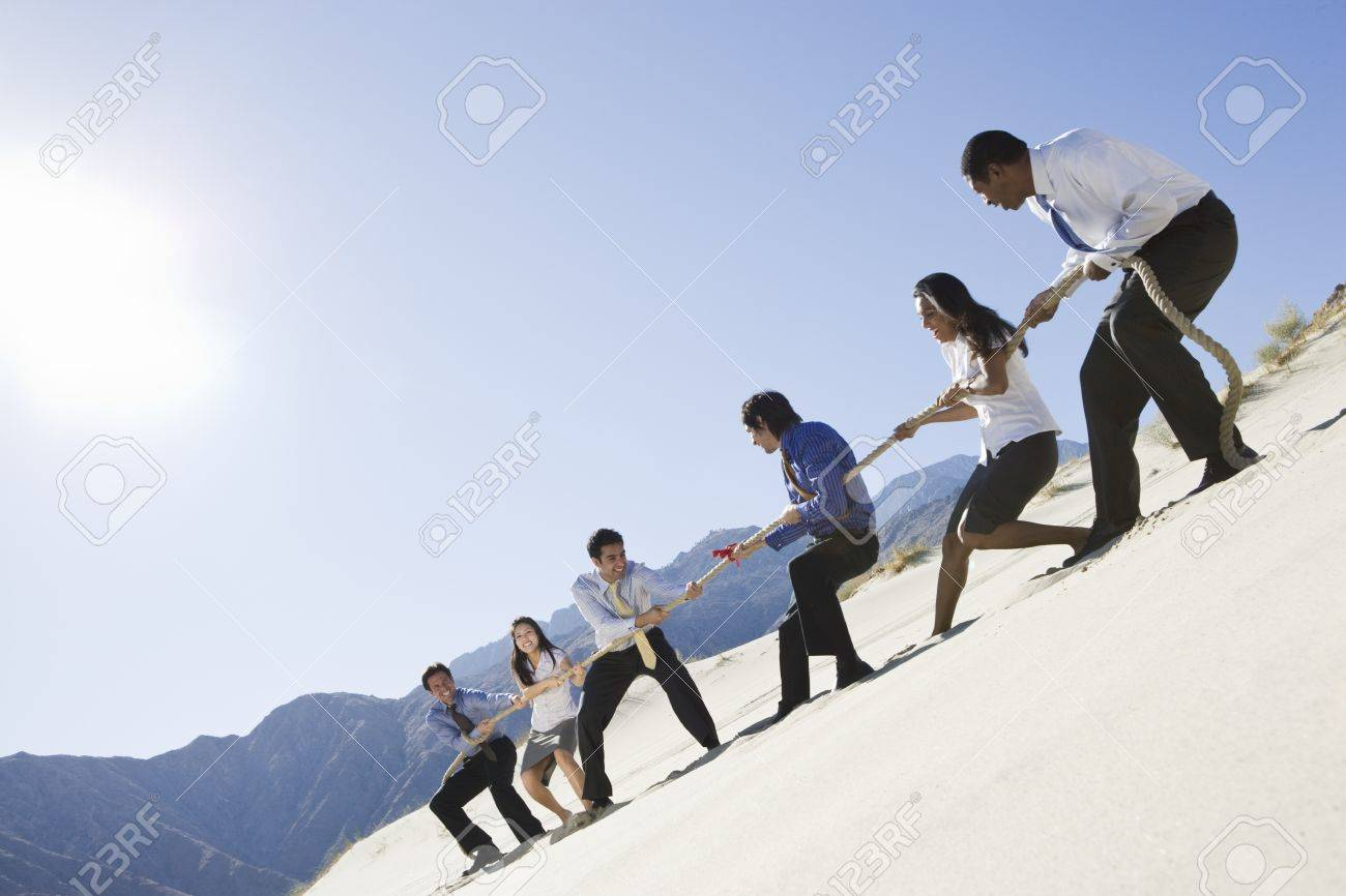 Business People Playing Tug of war in the Desert Stock Photo - 12735270