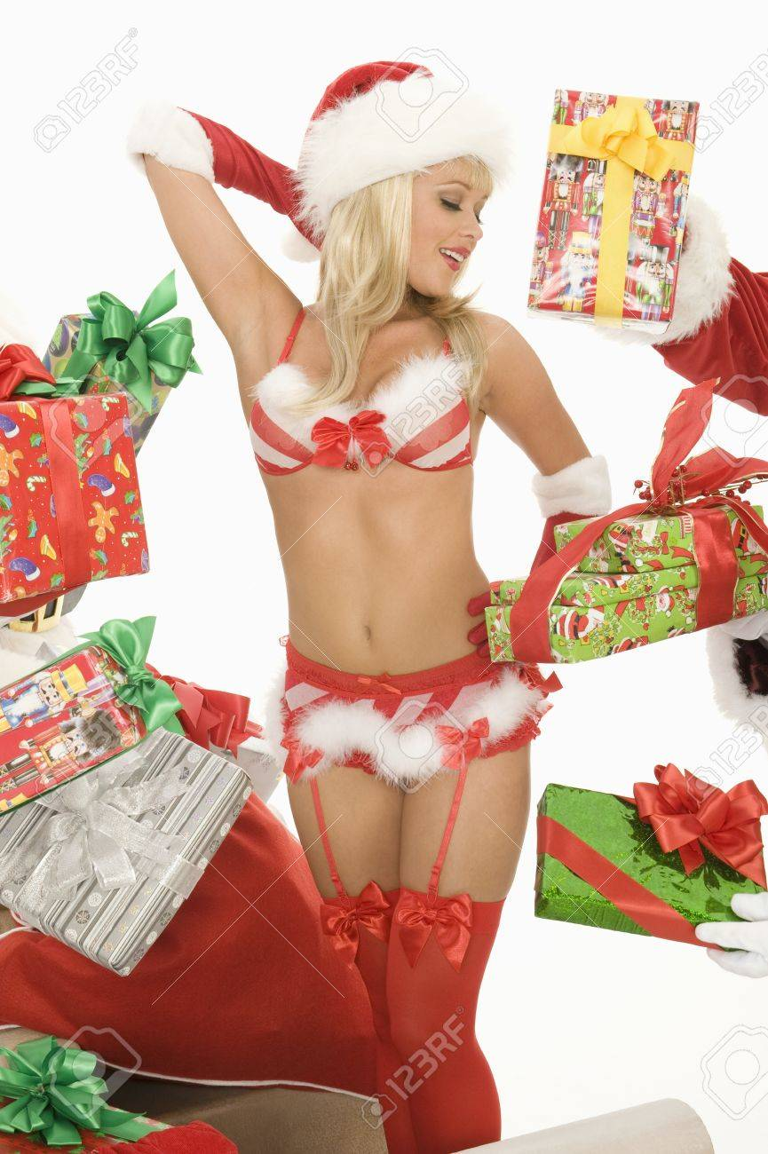 Mrs Claus in underwear surrounded by gifts Stock Photo - 12735166