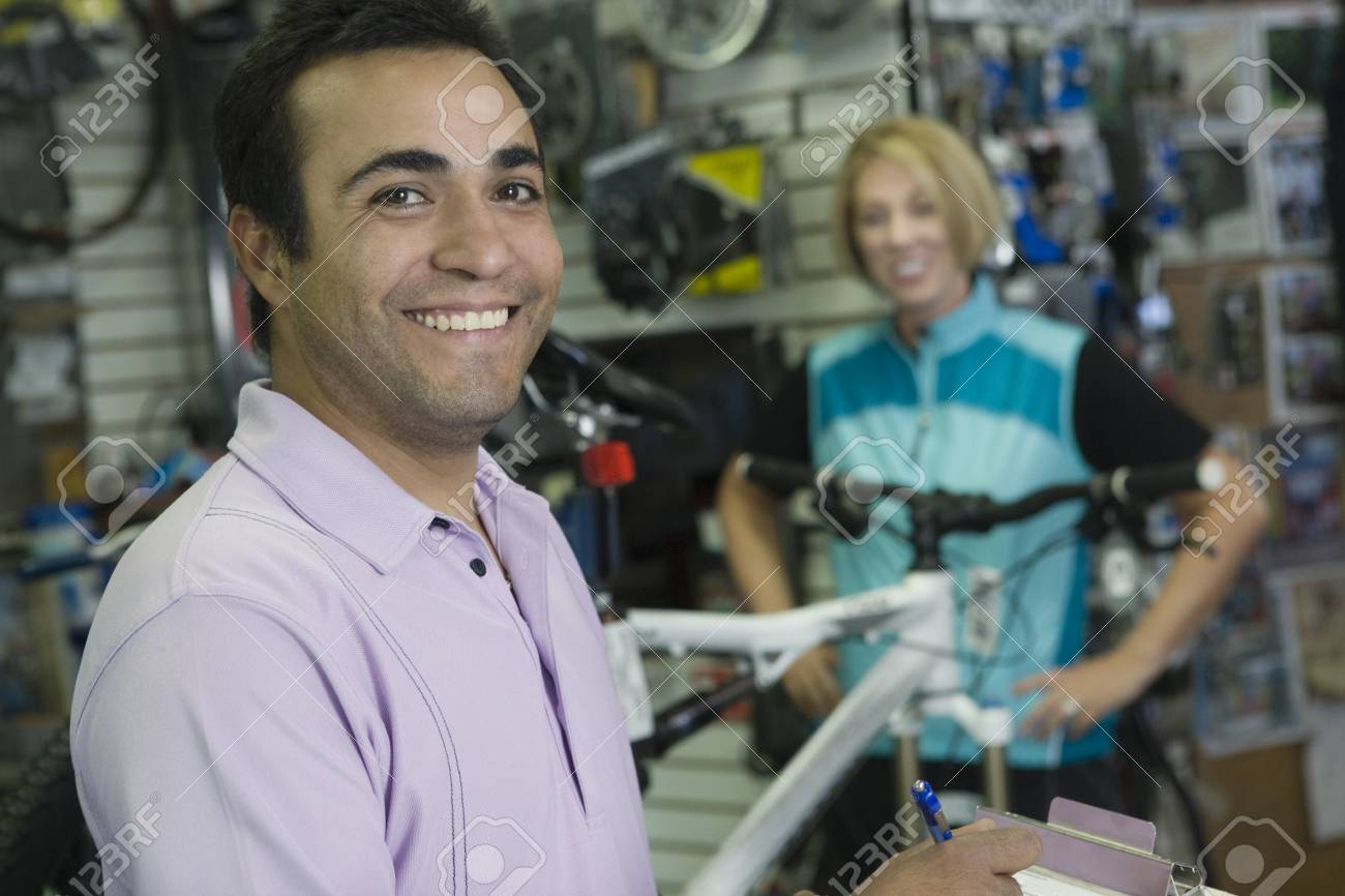 Bike shop assistant with female cyclist Stock Photo - 12735247