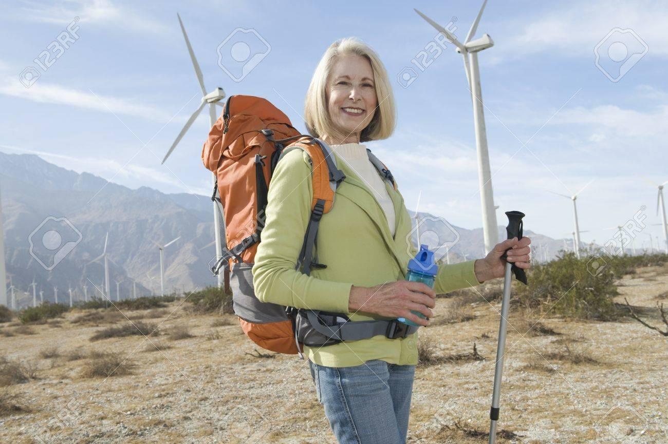 Senior woman with backpack near wind farm Stock Photo - 12737853