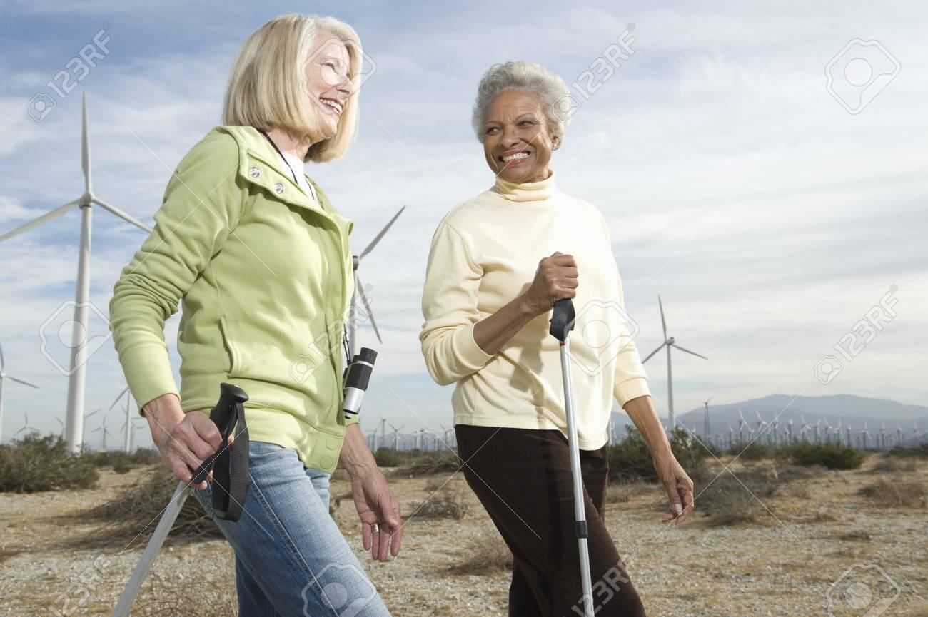 Women hiking near wind farm Stock Photo - 12737854