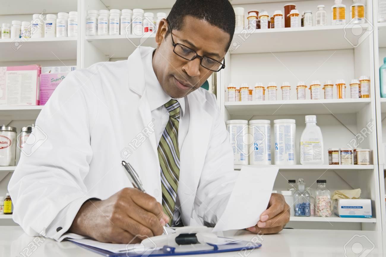 Male pharmactist working in pharmacy Stock Photo - 12737968
