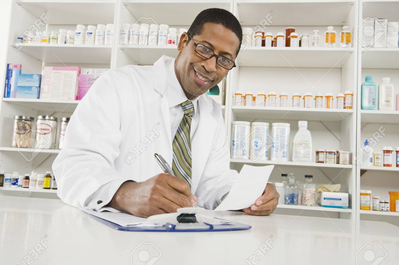 Male pharmactist working in pharmacy Stock Photo - 12737969
