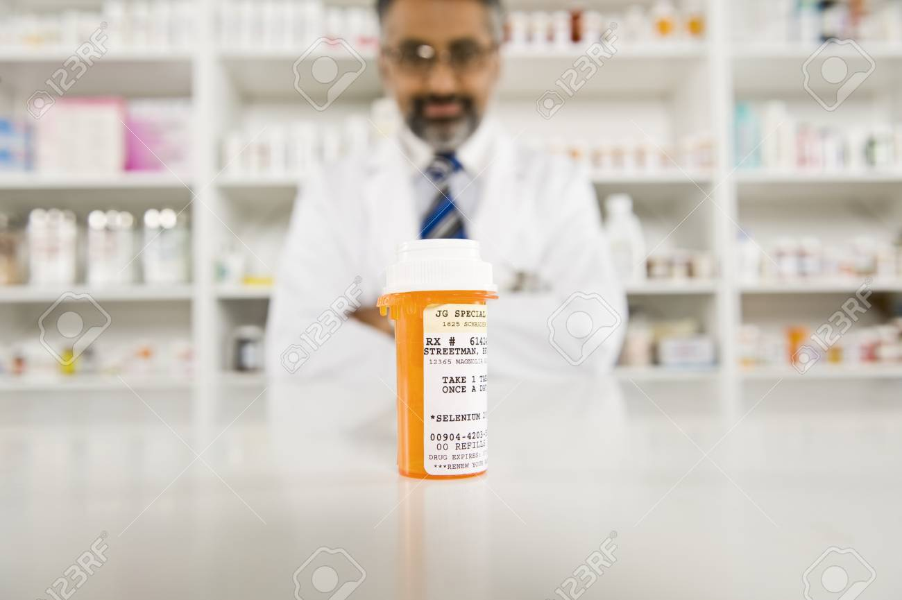 Prescription drugs and male pharmacist Stock Photo - 12737983