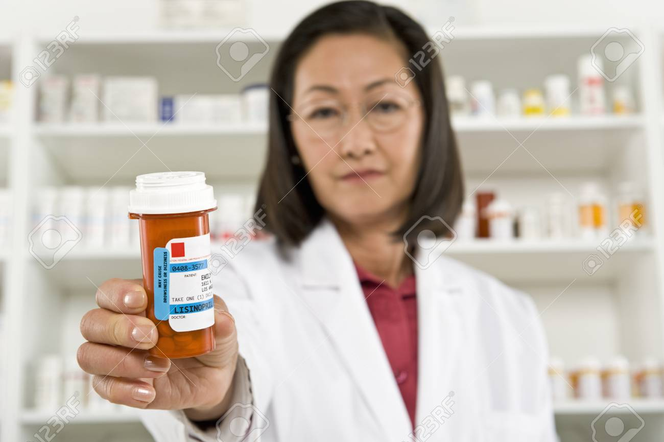 Female pharmactist holding prescription drugs Stock Photo - 12737989