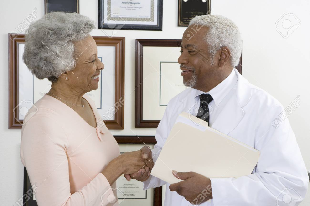 Senior medical practitioner and client Stock Photo - 12738065