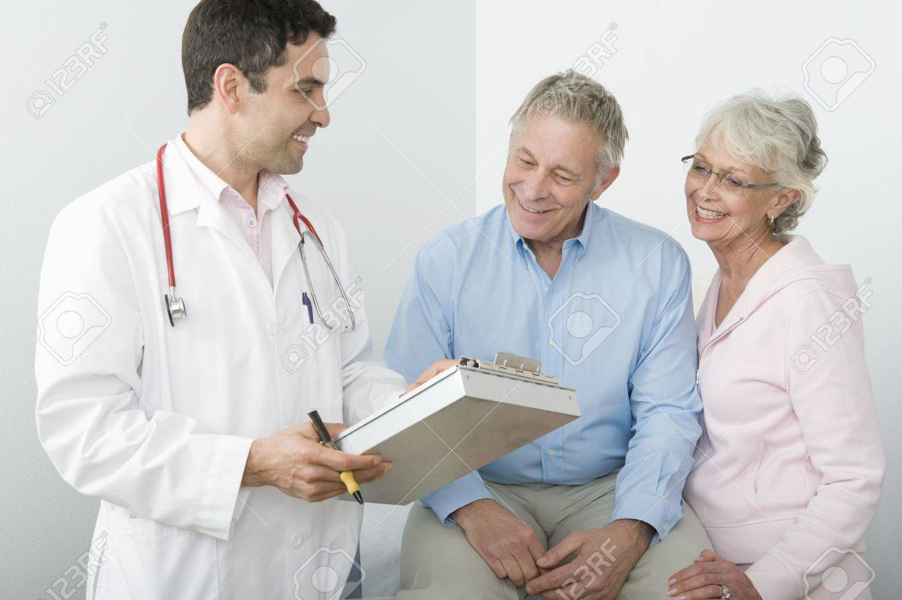 Mid adult doctor explains test results to senior couple Stock Photo - 12738111