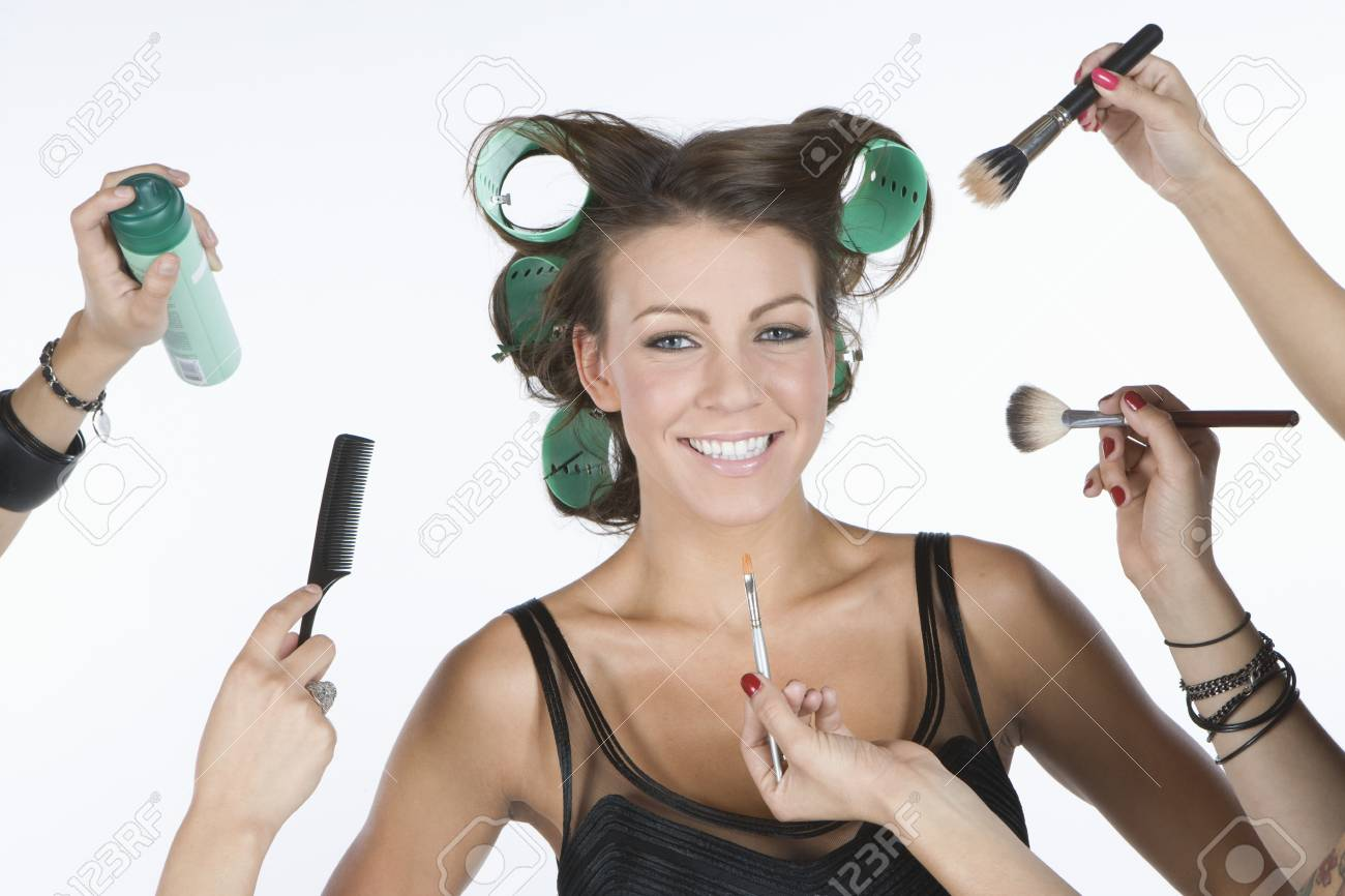 Woman in rollers  with cosmetics products on hand Stock Photo - 12738183