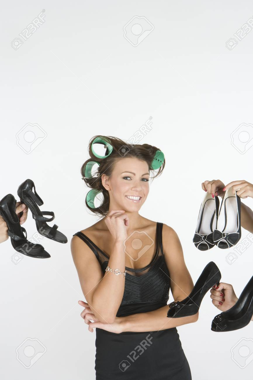 Woman in rollers with a choice of footwear on hand Stock Photo - 12738184