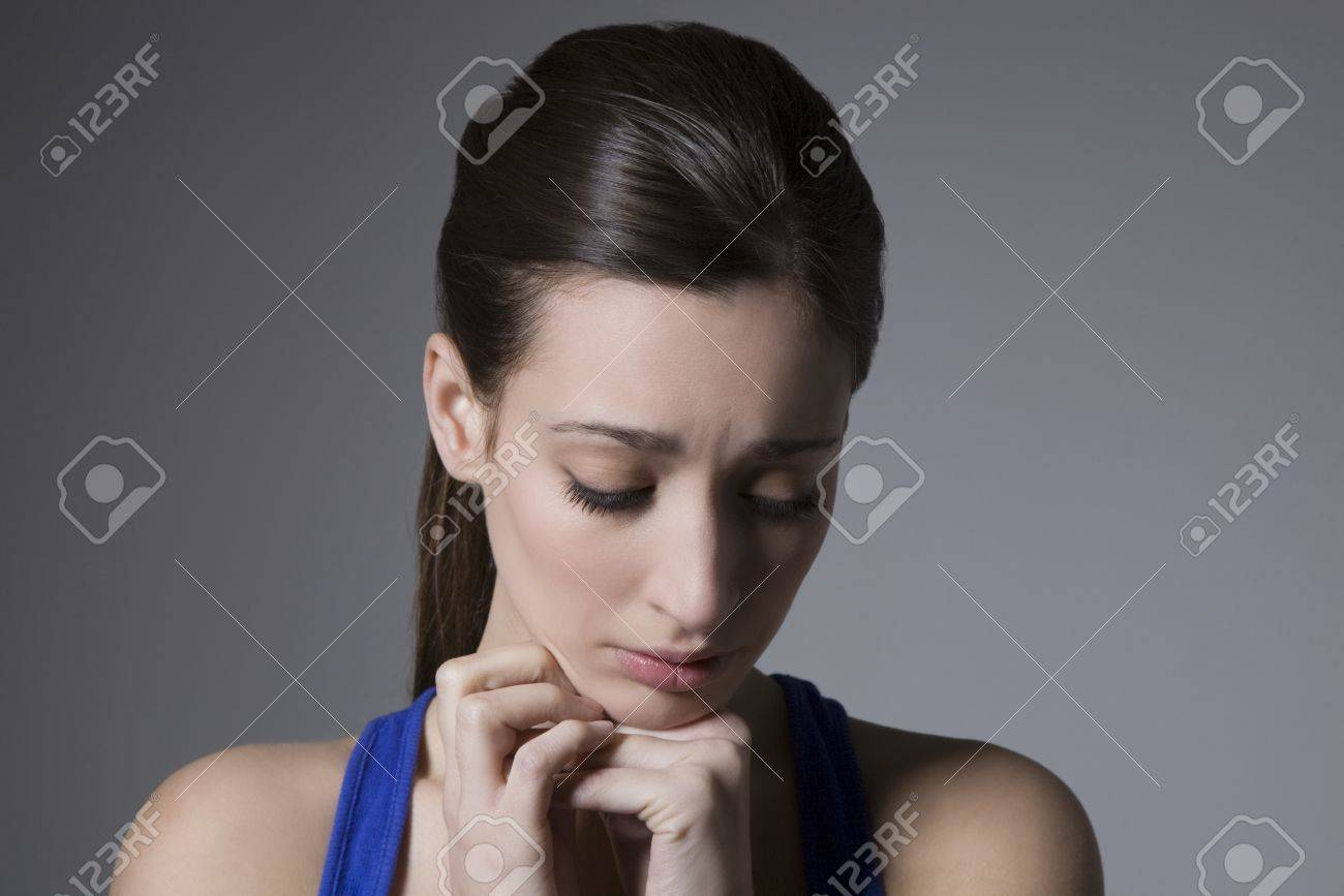 Brunette with head tilted down Stock Photo - 12738248