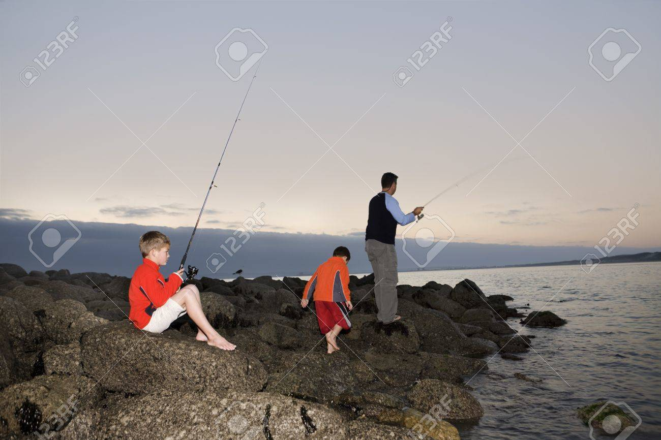 Father with two suns fishing on Paradise beach of Langebaan  South Africa Stock Photo - 12735524