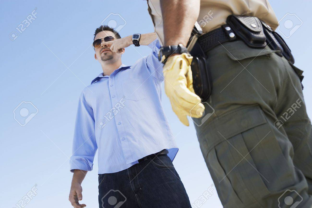 Cop Suspecting a Man of Drunk Driving Stock Photo - 18833634