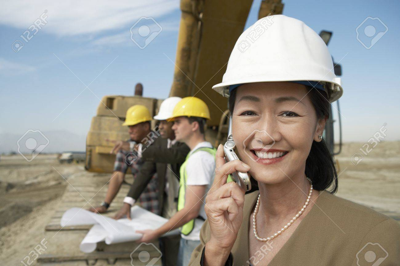 Surveyor Using Cell Phone on Construction Site Stock Photo - 18833706