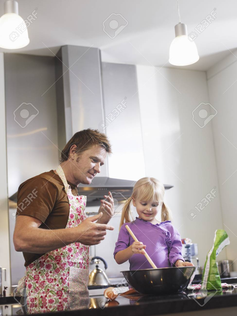 Girl (3-4) and father baking in kitchen Stock Photo - 19213517