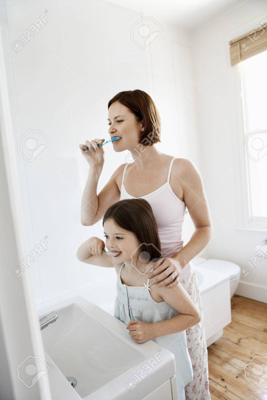 Mother and Daughter Brushing Teeth in bathroom Stock Photo - 19075825