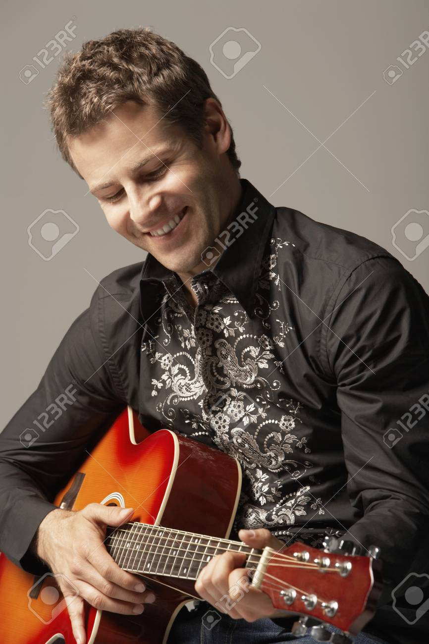 Man Playing Guitar smiling close-up Stock Photo - 19213781