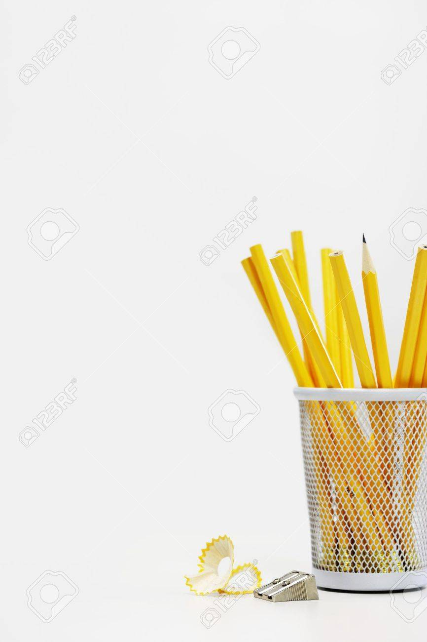 Group of yellow pencils in holder by sharpener Stock Photo - 19075904