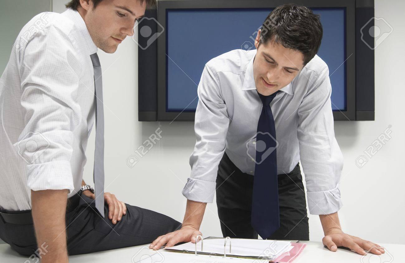 Two Businessmen Looking in File Folder Stock Photo - 18884213