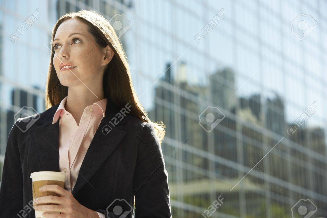 Office worker with drink outside office building portrait Stock Photo - 19184582