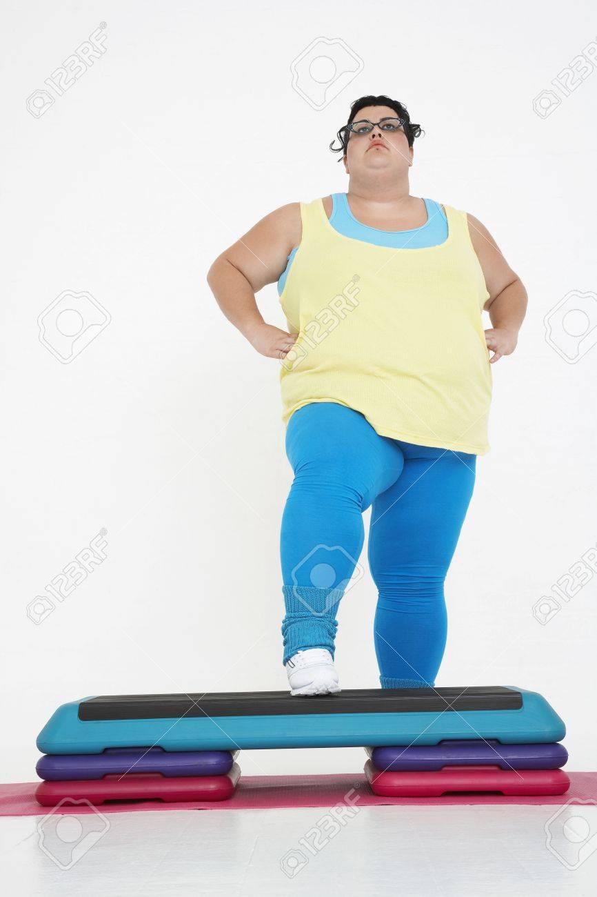 Woman Doing Step Aerobics Stock Photo - 18896488