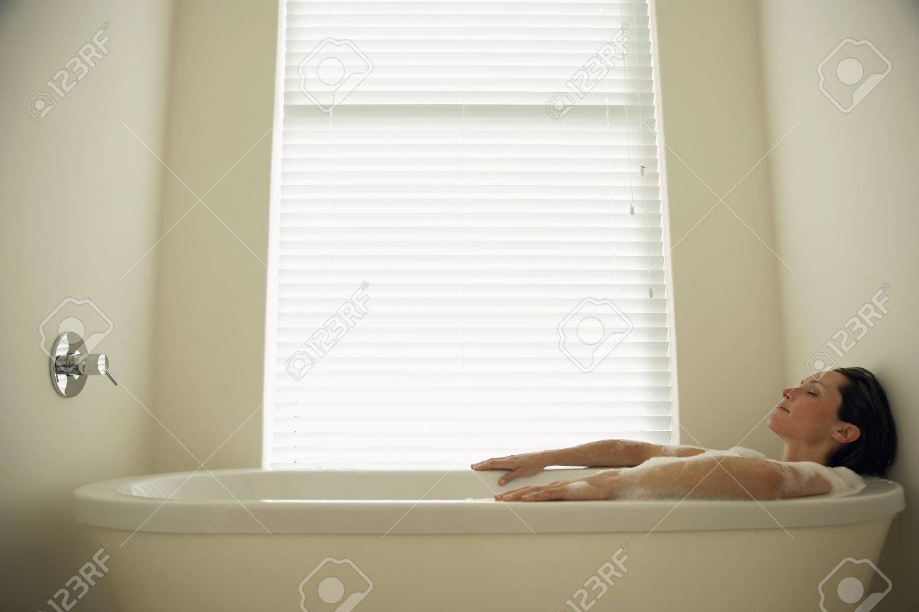 Woman Lying In Bath Tub Side View Stock Photo, Picture And Royalty ...