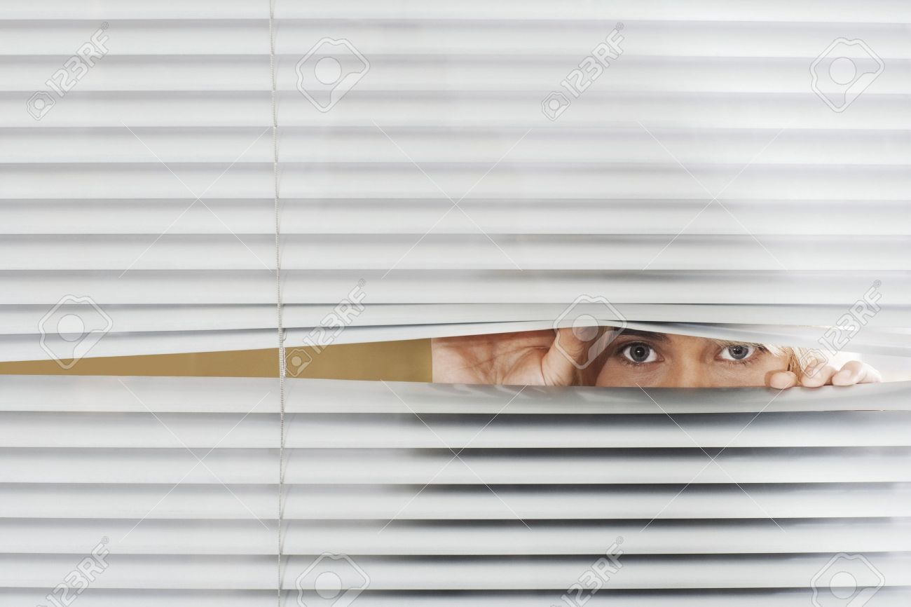 [Image: 18899192-Woman-Looking-Through-Venetian-...blinds.jpg]