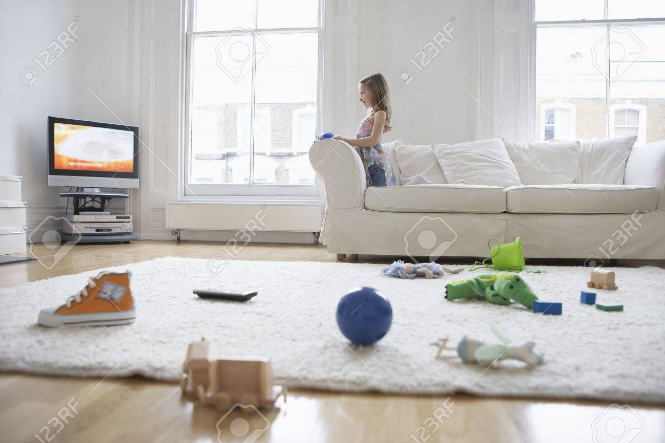 Girl Watching Television In Messy Living Room Stock Photo, Picture ...