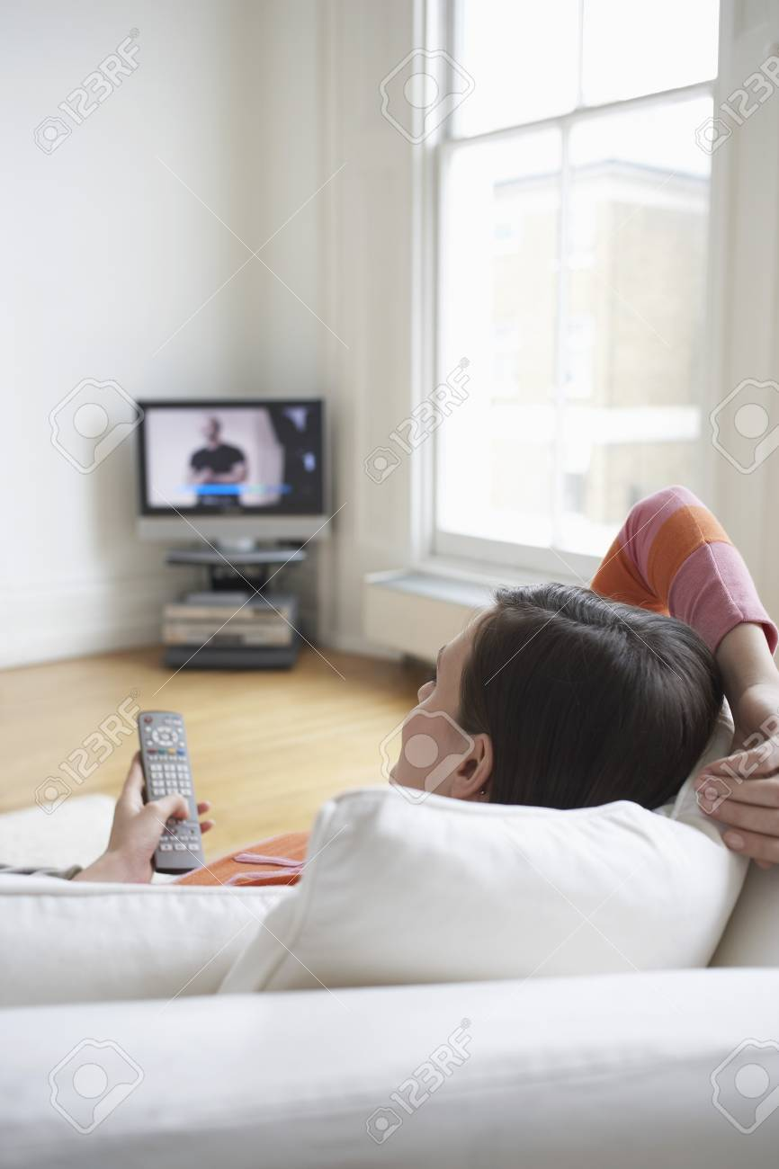 Woman Relaxing on Sofa and Watching Television Stock Photo - 19465744