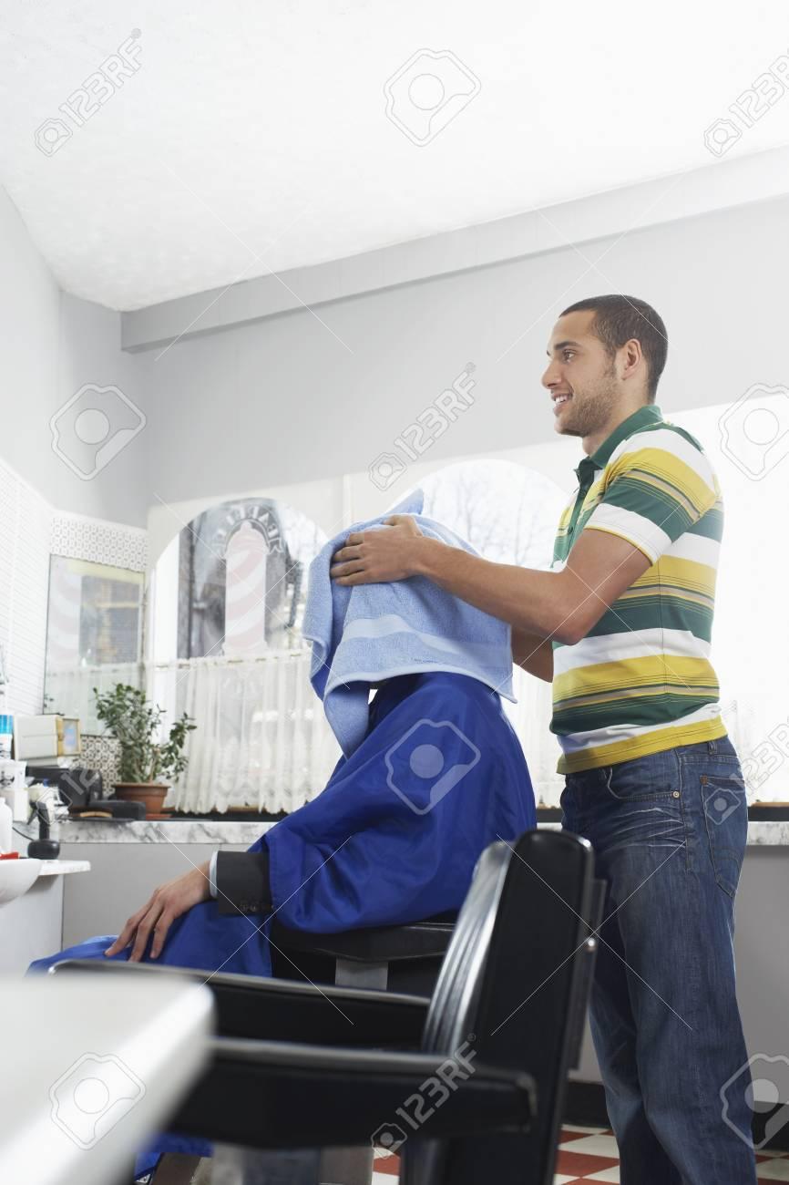 Barber preparing man for haircut in barber shop Stock Photo - 19076151