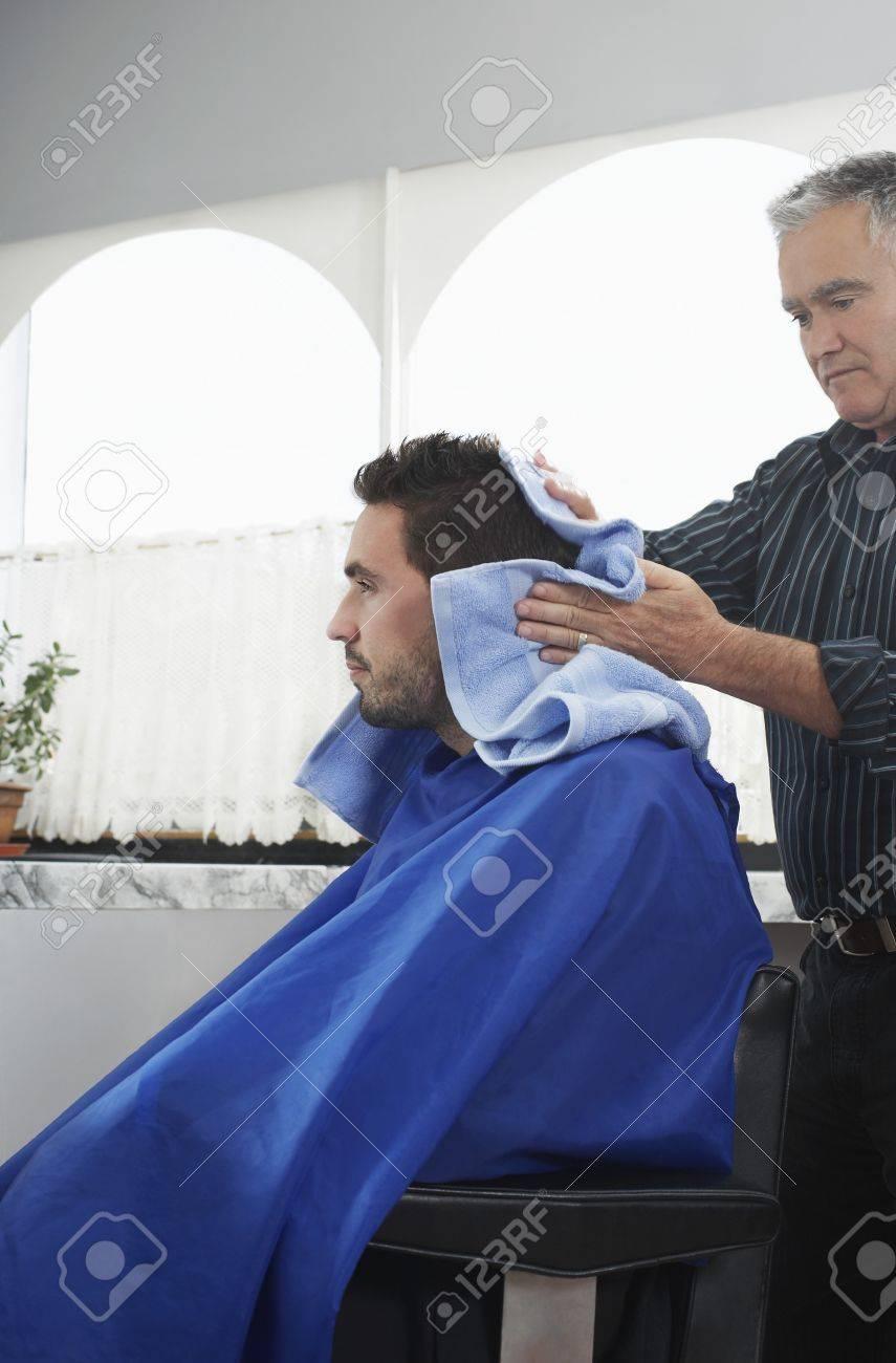 Barber preparing man for haircut in barber shop Stock Photo - 19076155