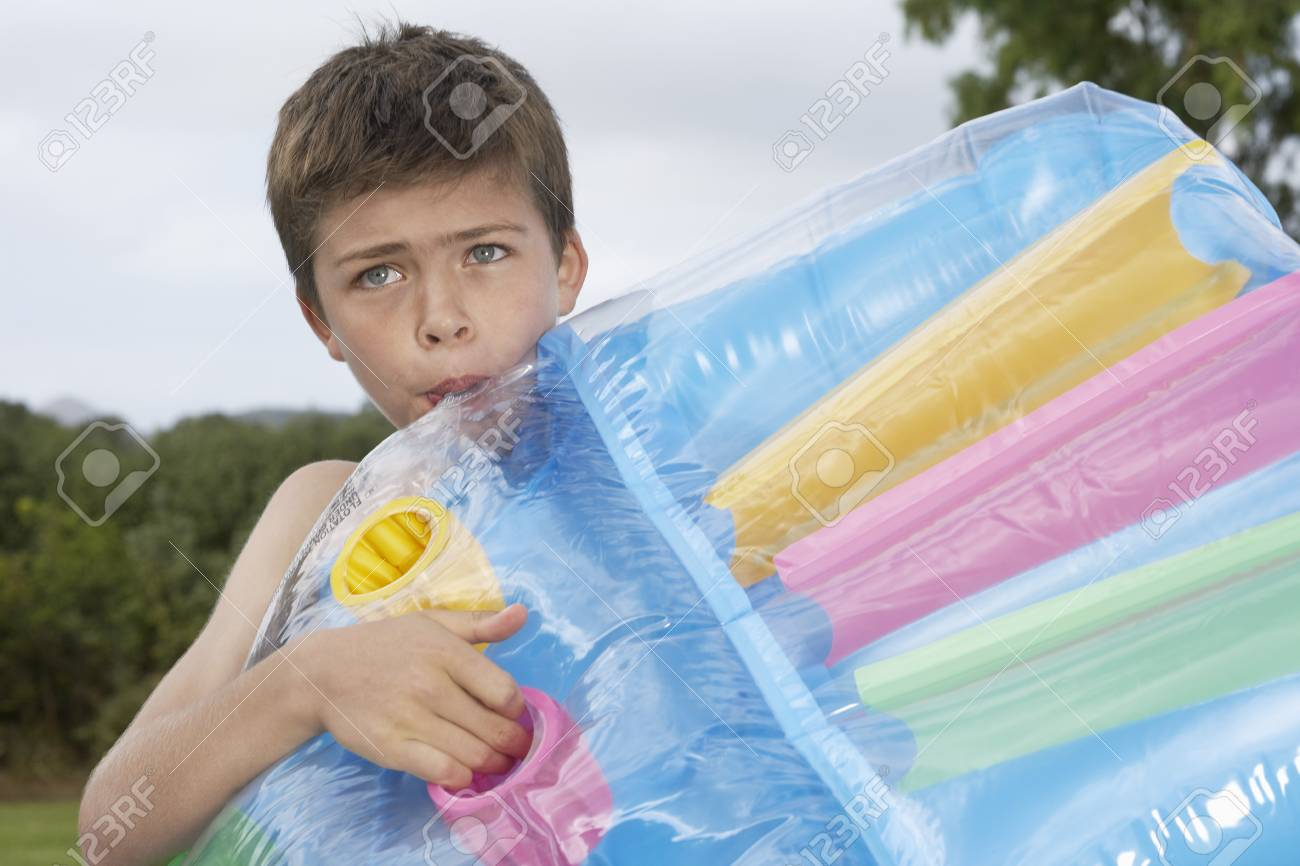 Boy 10 12 Blowing Up Air Mattress Stock Photo Picture And