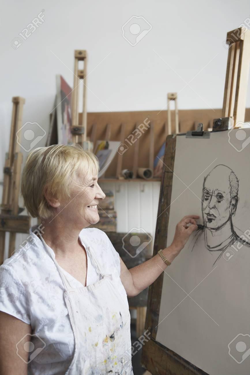 Senior woman in art class Stock Photo - 19078527