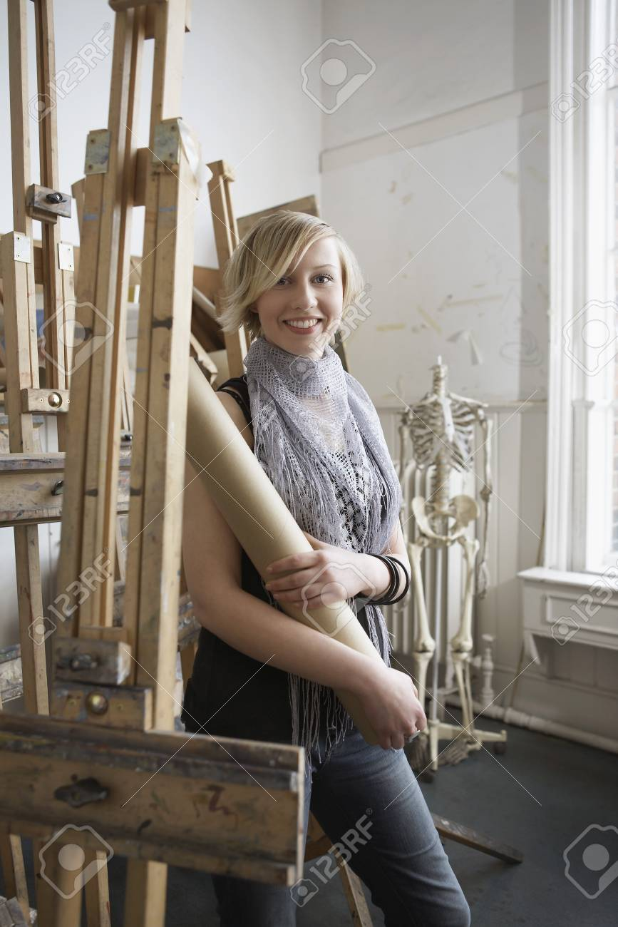 Female student standing among easels in art college Stock Photo - 19078566