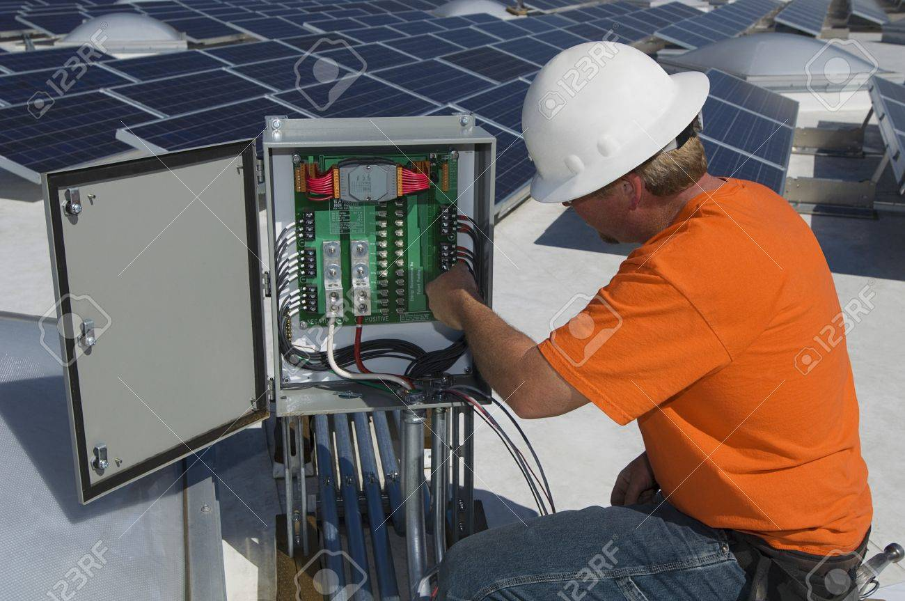 electrical engineer among solar panels at solar power plant stock photo 20715690 - Power Plant Engineer