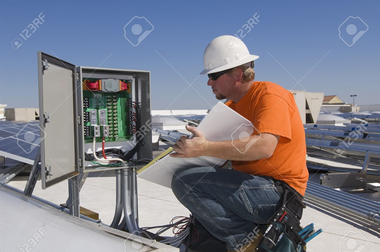 engineer working on electrical box at solar power plant stock photo 20715734 - Power Plant Engineer