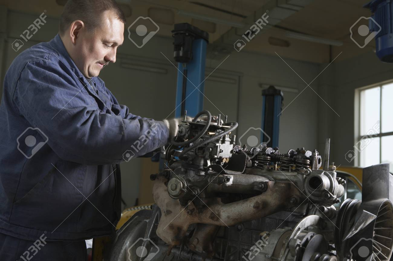 Mechanic Working on Motor Stock Photo - 20716324