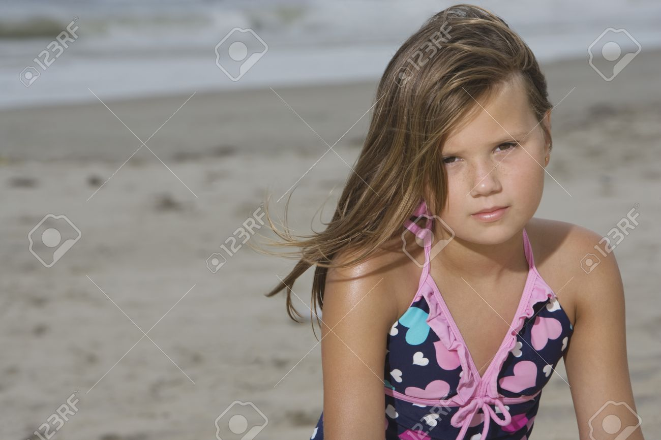 pre-teen nude 10 year old girls: Little Girl Sitting on a Beach