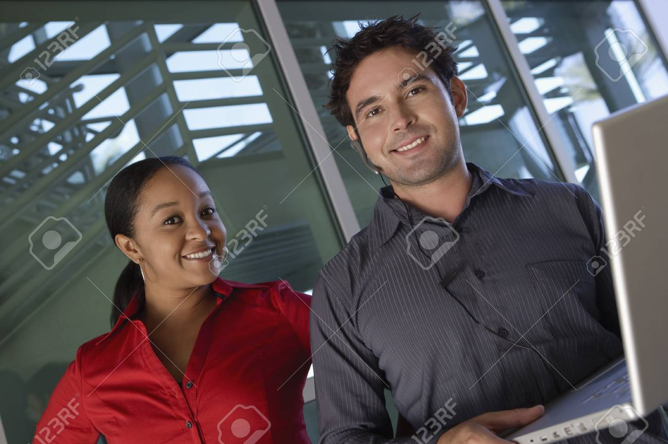 Man Using Laptop with Female Colleague Stock Photo - 20716727