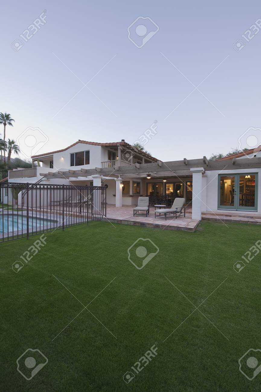 Lawn and swimming pool of Palm Springs home exterior Stock Photo - 20740022