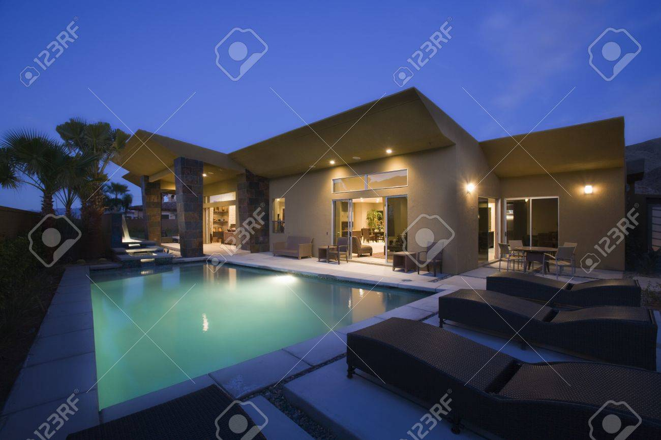 Mansion with pool at night  Lit Swimming Pool And House Exterior At Night Stock Photo, Picture ...