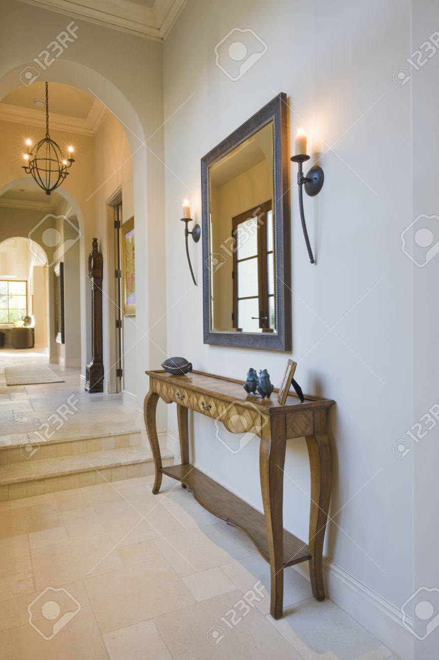 Antique console table with grey framed mirror in hallway Stock Photo - 20740690