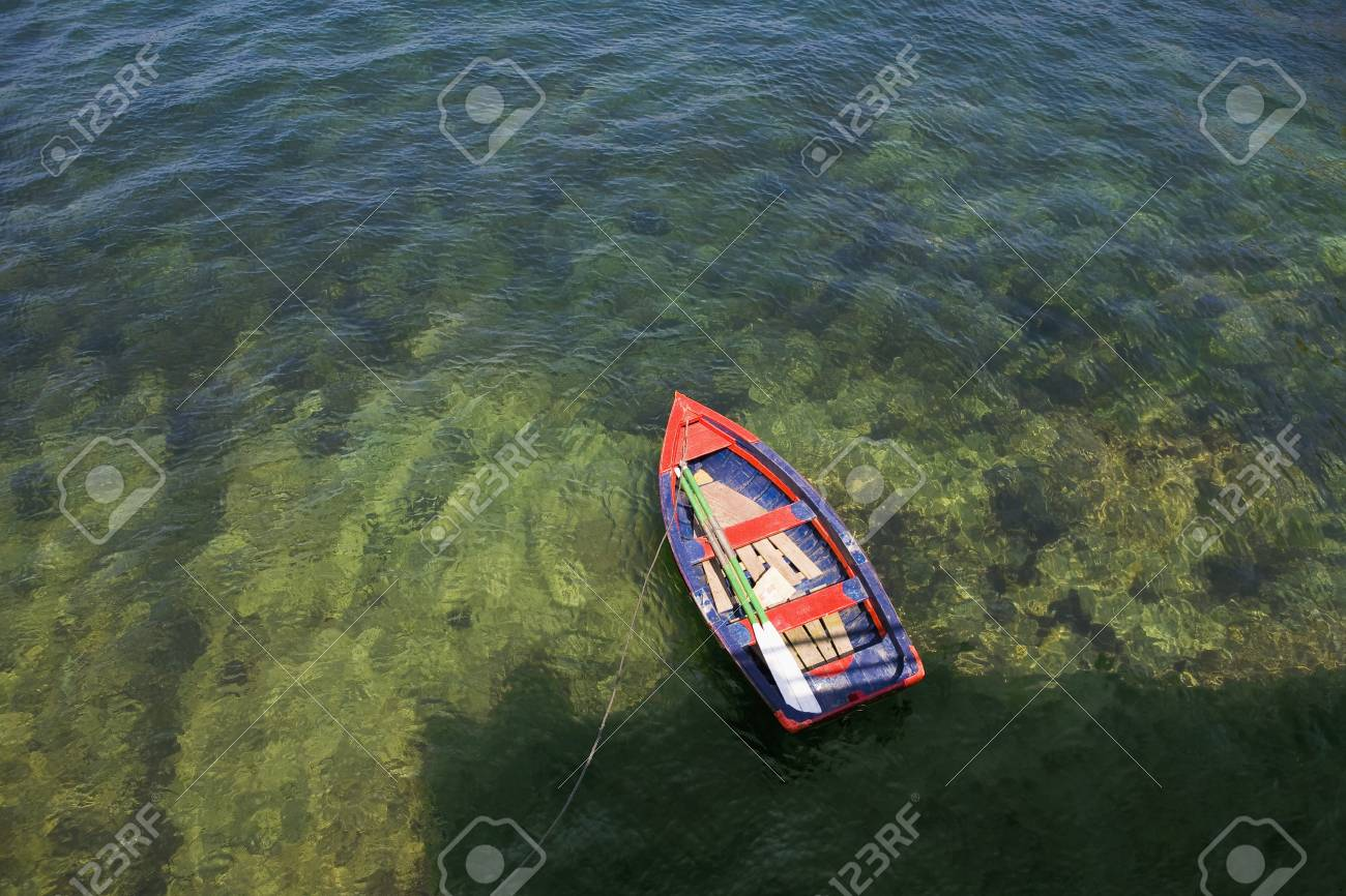 Rowing boat in shallow water Asurias Spain Stock Photo - 20741174