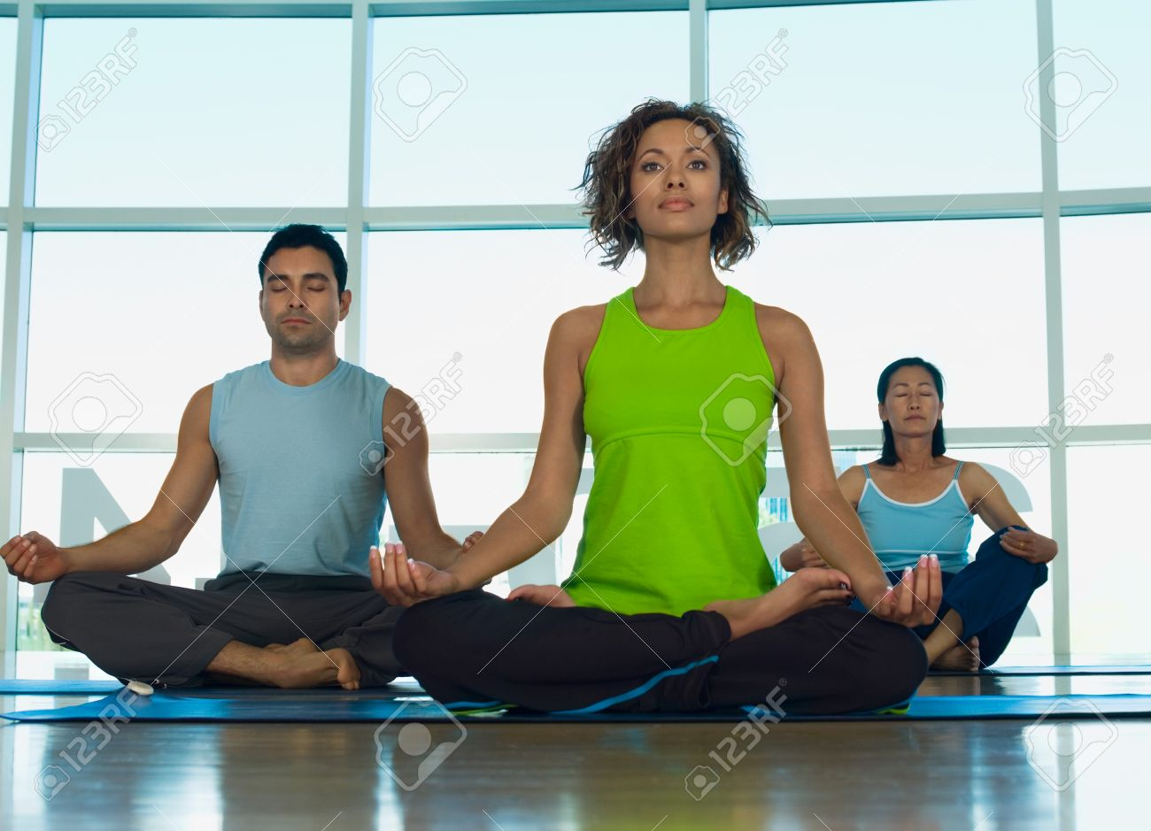 Three People Doing Yoga Indoors Stock Photo Picture And Royalty Free Image Image 21009600