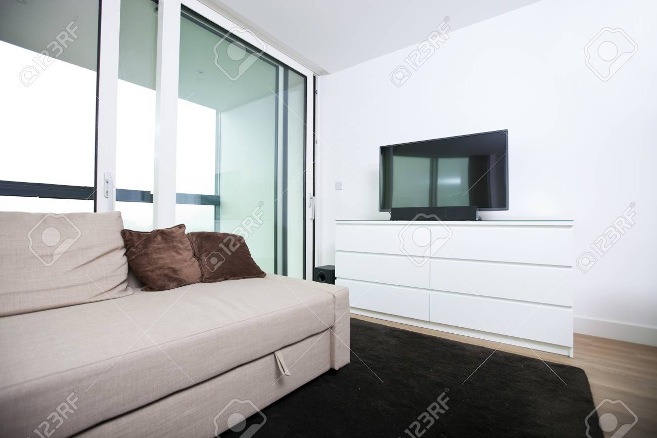 Living room with flat screen television in apartment Stock Photo - 25294718
