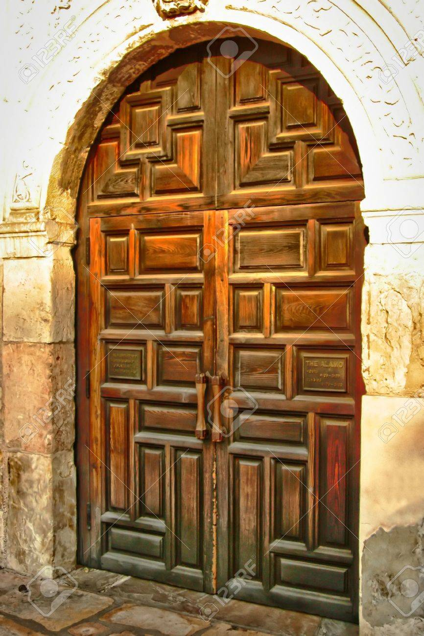 An old worn wooden door showing the grain of the wood Stock Photo - 3042641