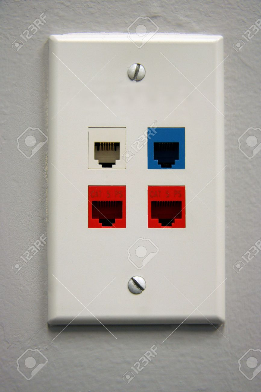 A White Telephone Data Outlet With 4 Plugs For US Data Stock Photo ...