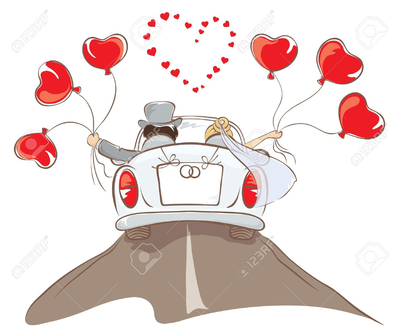 The bride and groom riding in a car - 12486469