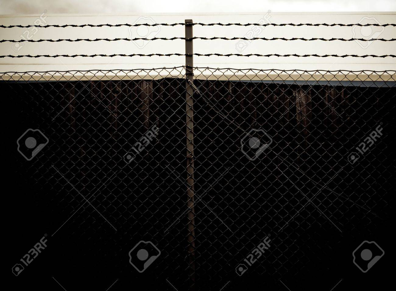 dark old prison fence with barbed wire Stock Photo - 2349088